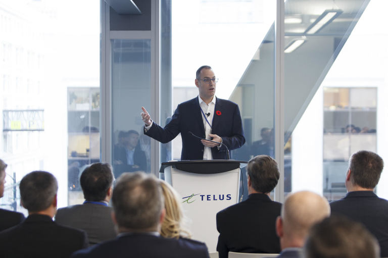 MC speaks at the Identity North Conference at Telus Garden.